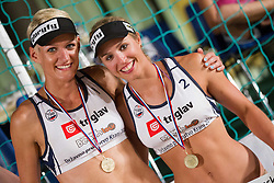 Andreja Vodeb and Simona Fabjan during medal ceremony after the final matches of Slovenian National Championship in beach volleyball Kranj 2012, on June 30, 2012 in Kranj, Slovenia. (Photo by Vid Ponikvar / Sportida.com)