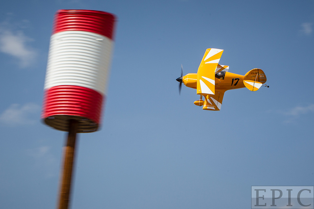 RENO, NV - SEPTEMBER 15: #17 Eric Zine rounds a pylon during the biplane heat at the Reno Championship Air Races on September 15, 2017 in Reno, Nevada. (Photo by Jonathan Devich/Getty Images) *** Local Caption *** Eric Zine