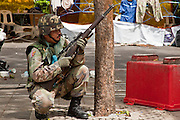 May 19 - BANGKOK, THAILAND: A Thai Army sniper works his way into position in Lumpini Park during the Thai government crack down against Red Shirt and anti government protesters. The Royal Thai Army attacked anti-government protesters May 19 with troops and armored personnel carriers. Photo by Jack Kurtz