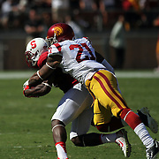 Samoan heritage Trojan Safety, Su'a Cravens, tackles Cardinal star receiver Ty Montgomery during the 2nd half.  USC prevailed over Stanford 13-10 at Stanford Stadium, Palo Alto, California.   Photo by Barry Markowitz, 12:30pm, 9/06/14