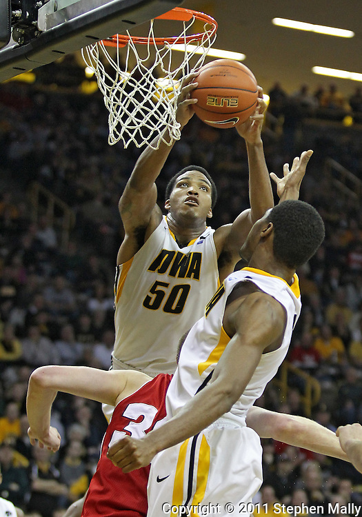February 09 2011: Iowa Hawkeyes forward Jarryd Cole (50) grabs a rebound during the second half of an NCAA college basketball game at Carver-Hawkeye Arena in Iowa City, Iowa on February 9, 2011. Wisconsin defeated Iowa 62-59.