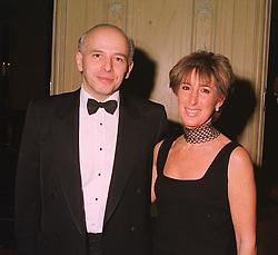 MR & MRS JONATHAN CAPLAN QC. at a dinner in London on 17th November 1998.MMB 27