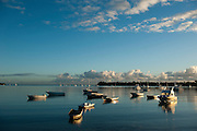 A view over boats on Grand Baie or Grand Bay. Early morning.