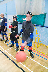 Team Player throwing the ball during Goalball training; a threeaside game developed for the visually impaired and played on a volleyball court, A specially adapted ball containing an internal bell is used,