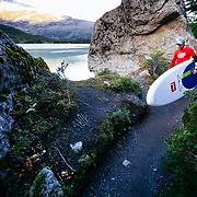 Chris Theobald heading into Bernardo O'Higgins National Park to paddle board near the Balmaceda Glacier in Chile.