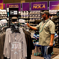 Jan 27, 2013; New Orleans, LA, USA; Joesph Sims of San Antonio, Texas views Super Bowl XLVII merchandise for sale inside the NFL Shop at the Convention Center. Super Bowl XLVII between the Baltimore Ravens and the San Francisco 49ers will be played on February 3, 2013 and the Mercedes-Benz Superdome.  Mandatory Credit: Derick E. Hingle-USA TODAY Sports