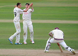 Nottinghamshire's Matt Carter and Will Gidman celebrates the wicket of Somerset's Peter Trego. - Photo mandatory by-line: Harry Trump/JMP - Mobile: 07966 386802 - 17/06/15 - SPORT - CRICKET - LVCC County Championship - Division One - Day Four - Somerset v Nottinghamshire - The County Ground, Taunton, England.