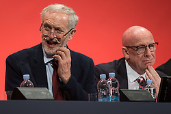© Licensed to London News Pictures . 30/09/2015 . Brighton , UK . JEREMY CORBYN (l) listens as Heidi Alexander speaks to the conference . The 2015 Labour Party Conference . Photo credit : Joel Goodman/LNP