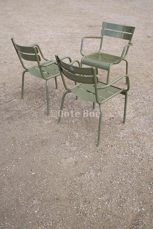 3 empty metal outdoor chairs