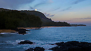 Full moon setting, dawn, Lumahai Beach,Kauai, Hawaii