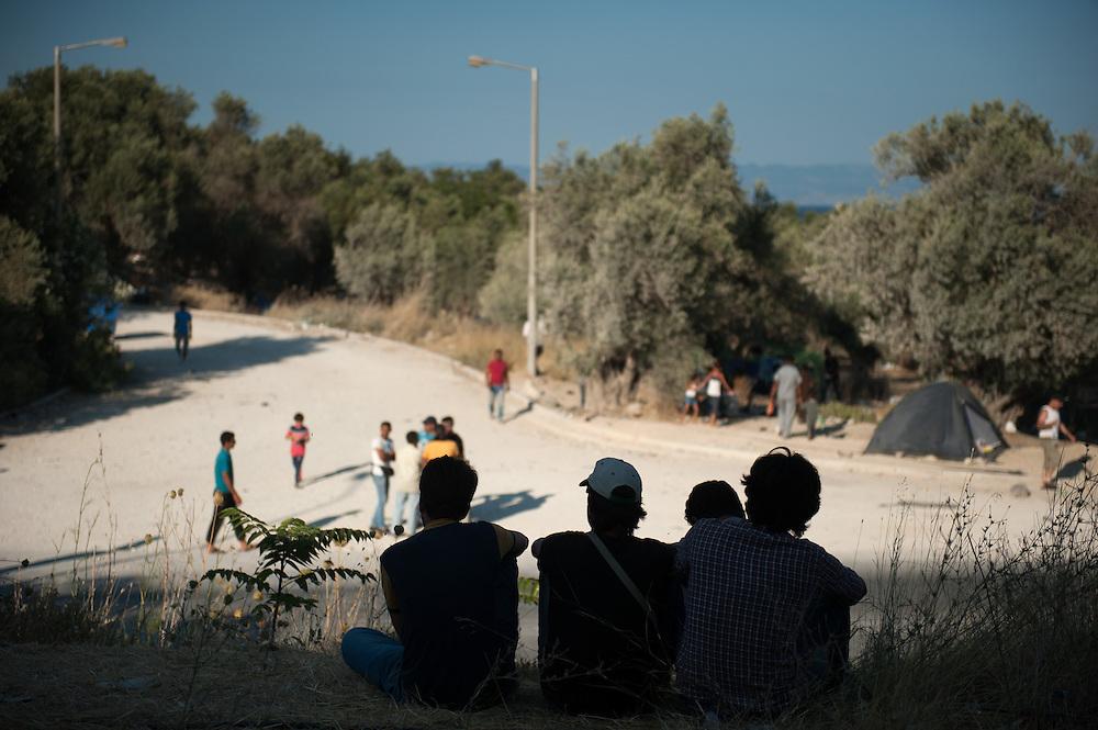 Refugees waiting opposite the entrance of Kara Tepe camp.