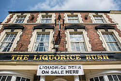© Licensed to London News Pictures. 12/07/2015. Pontefract, UK. Picture shows the Liquorice bush pub.  Thousands of people have again turned out in Pontefract to celebrate all things Liquorice including sweets, beer, bread, pies, jam & jewellery . The town famed for the Pontefract cake has a 400 year history with Liquorice, it is believed Cluniac monks brought it to the area in the mid 1500 & introduced it as a medicine. Photo credit : Andrew McCaren/LNP