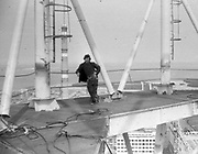 """AMAZING Photo Film discovered Documenting Work In Chernobyl <br />Chernobyl worker Aleksandr Shubovskiy captures rare images <br /><br />During one of the days in 1979-80, when the erection of Ventilation Stack VT-2 common for the third and fourth (not existed at that time) Chernobyl NPP Units was coming to the end, Aleksandr Shubovskiy, who was working within a combined installation crew in a company named """"Spetsenergomontazh"""", arranged with the colleagues a small photo session on his own,They had their pictures taken.<br /><br />The author processed the film and put it on a wardrobe without printing until he had time to print the images. The moment to print the film somehow did not happen, while in February 1986 Aleksandr hit the road for a on a different site in Yakutia. And there he was caught by news about the accident at Chernobyl.<br /><br />A year later, when a Aleksandr  managed to get into his looted flat in the evacuated Pripyat, he discovered an untouched package with films. He brought them home and… forgot for almost 40 years…the printed photographs which no one and never have seen before until now<br /><br />Photo shows: Members of a combined crew. All equipped with safety harnesses, chains and hooks for working at heights.<br />©Aleksandr Shubovskiy/Exclusivepix Media"""