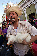 A man dressed as a traditional peasant parade through the streets of Old San Juan during the Festival of San Sebastian in San Juan, Puerto Rico.