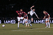 Jack Marriott, Charlie Goode and Vadaine Oliver compete for the ball during the The FA Cup match between Northampton Town and Derby County at the PTS Academy Stadium, Northampton, England on 24 January 2020.