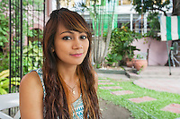 Portrait of beautiful young woman smiling outdoors; Manila; Philippines
