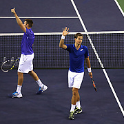 Vasek Pospisil and Jack Sock defeat Bob and Mike Bryan at the 2015 BNP Paribas Open in Indian Wells, California on Thursday, March 19, 2015.<br /> (Photo by Billie Weiss/BNP Paribas Open)