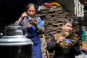 Nomadic yak herder Karsal and his wife Phurba eat inside their handmade yak wool tent home in the Tibetan Plateau. (Karsal is featured in the book What I Eat: Around the World in 80 Diets.) MODEL RELEASED.