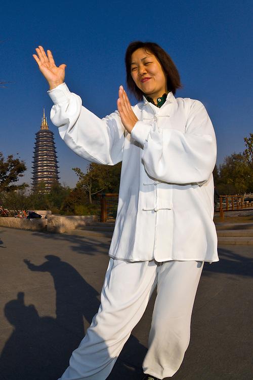 Tai chi, Red Plum Park, Tianning Pagoda in background,  Changzhou, China