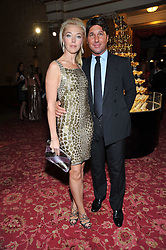 TAMARA BECKWITH and her husband GIORGIO VERONI at a party to celebrate 300 years of Tatler magazine held at Lancaster House, London on 14th October 2009.