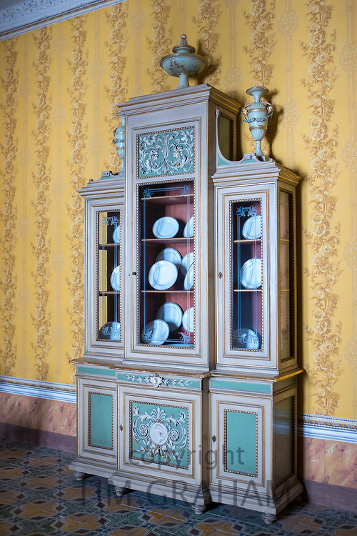 Dresser with fine china porcelain in the Room of Conversation - Yellow Room - Palazzo Nicolaci di Valladorata, Noto, Sicily