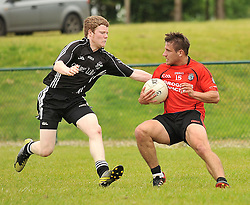 Ballyhaunis's Niall Prenty tries to get past Tourmakeady's Donal Breathnach<br /> Pic Conor McKeown