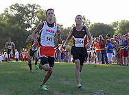 Prairie's Mitch Pritts (545) and Linn-Mar's Tanner Rathje (1064) battle it out as they reach the finish line during the Cedar Rapids Invitational at Noelridge Park in Cedar Rapids on Thursday, September 6, 2012. Pritts placed fifthand Rathje sixth.