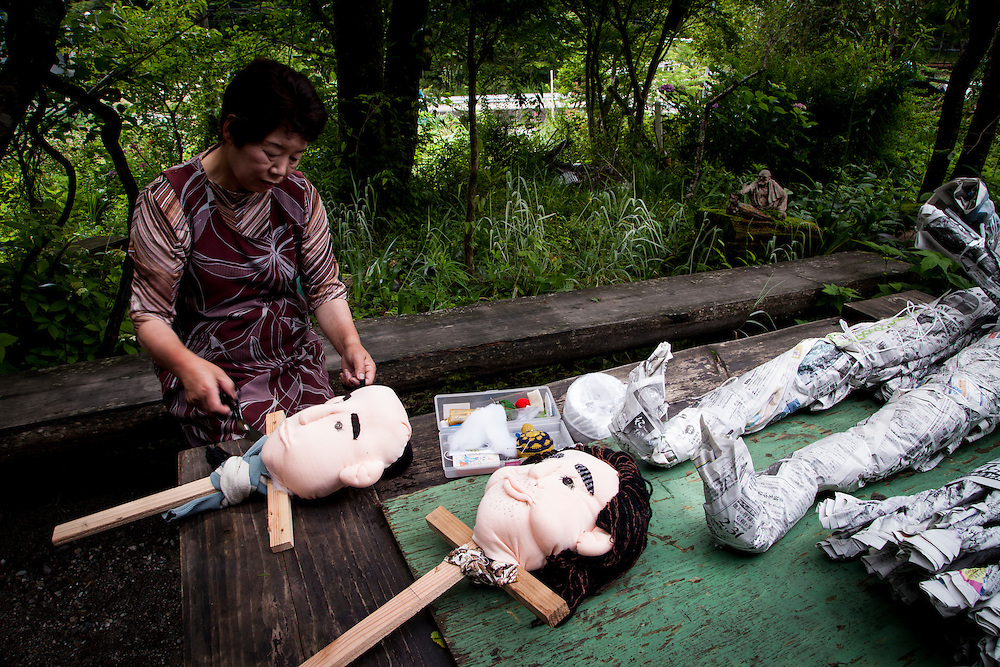 MIYOSHI, JAPAN - JULY 11 : Resident Tsukimi Ayano making a hand made doll in front of her house in Nagoro village, in Miyoshi, Japan on July 11, 2015. <br /> <br /> Photo: Richard Atrero de Guzman