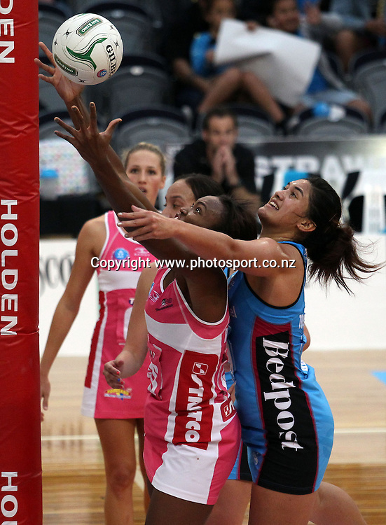 Carla Borrego of the Thunderbirds and Sulu Tone-Fitzpatrick compete for the ball.<br /> ANZ Championship Netball - Southern Steel v Adelaide Thunderbirds, 6 April 2013, Lion Foundation Arena - Edgar Centre, Dunedin, New Zealand.<br /> Photo: Rob Jefferies / photosport.co.nz