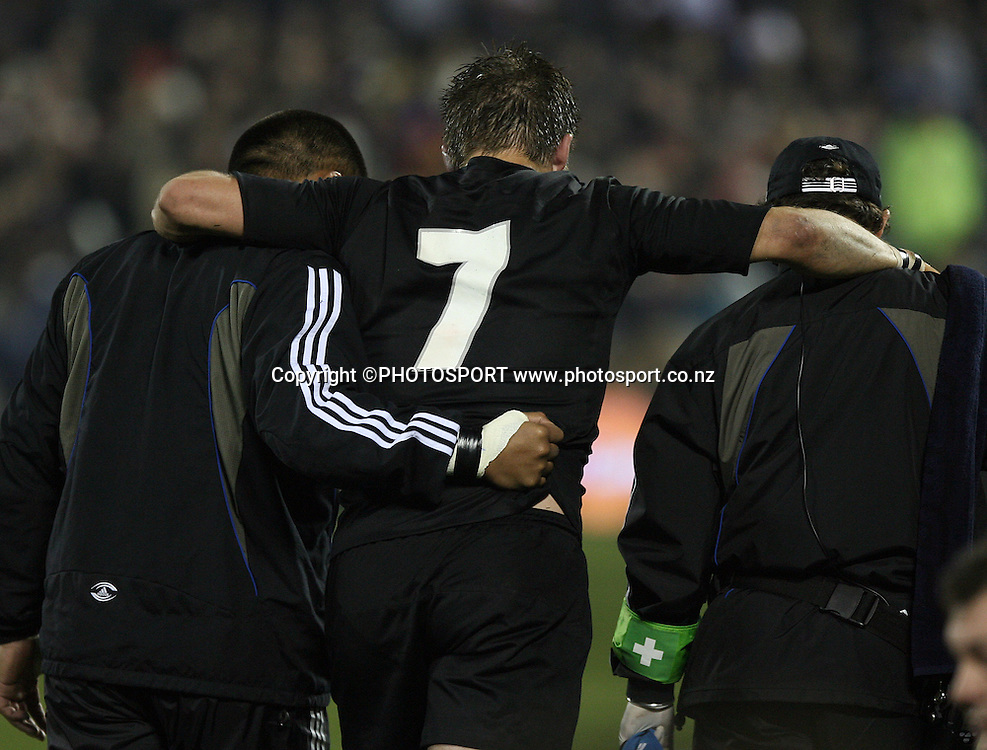 All Blacks captain Richie McCaw is helped from the field.<br />Iveco test match series, All Blacks v England, 2nd Test, AMI Stadium, Christchurch, Saturday 14 June 2008. Photo: Marc Weakley/PHOTOSPORT