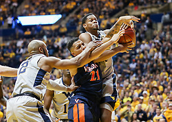 Dec 5, 2017; Morgantown, WV, USA; West Virginia Mountaineers forward Sagaba Konate (50) and Virginia Cavaliers forward Isaiah Wilkins (21) fight for a loose ball during the first half at WVU Coliseum. Mandatory Credit: Ben Queen-USA TODAY Sports