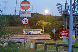 © Licensed to London News Pictures. 06/09/2012. London, UK . A bomb disposal robot attends to a suspicious device on the front of a police car that closed the M25 motorway Dartford Bridge and Tolls in both directions on 6th September 2013. One man arrested and a suspicious item found resulting in traffic tailbacks for 7 hours.. Photo credit : Shaun Petri/LNP