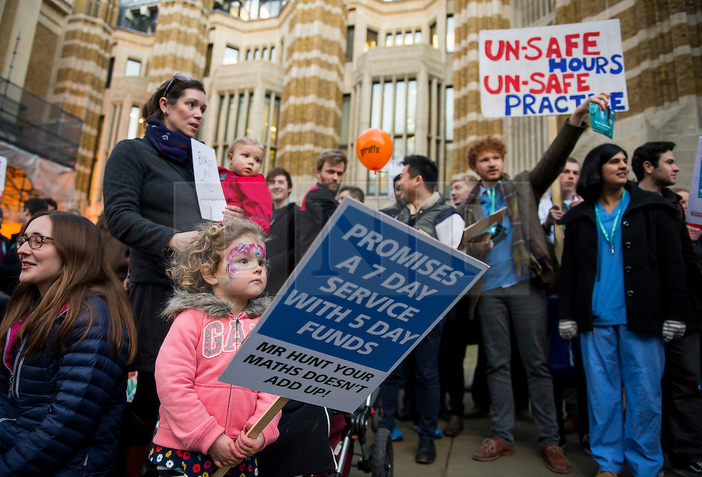 © Licensed to London News Pictures. 11/02/2016. London, UK. A young girl holds up a banner as Junior Doctors and supporters protest outside the Department of Health in Westminster London following Jeremy Hunt's announcement to Parliament that he will force through a new junior doctors contract against their will. Photo credit: Ben Cawthra/LNP