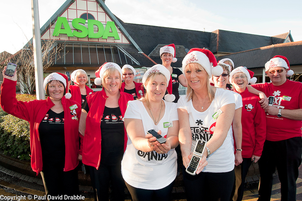 Text Santa  Charity Campaign Launch People Manager Sue Stringer front right with Asda collueuages Barrow Road Asda Harrogate. .www.pauldaviddrabble.co.uk.6 December 2011  Image © Paul David Drabble