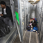 WASHINGTON, DC-OCT14: John Charles, 23, folds a towel in his storage unit at Capital Self-Storage, October 16, 2015, while Michael Evans organizes his unit below. Many of the area homeless have possessions they want to keep safe, just nowhere permanent to live, so they store their belongings at Capital Self-Storage, where an upper-level unit costs $30/month. Some of the homeless patrons also spend their days in their storage units, when shelters are closed during midday hours. The storage facility near 3rd and Florida Avenue in Northeast, Washington, DC, is about to be replaced by a boutique hotel. (Photo by Evelyn Hockstein/For The Washington Post)