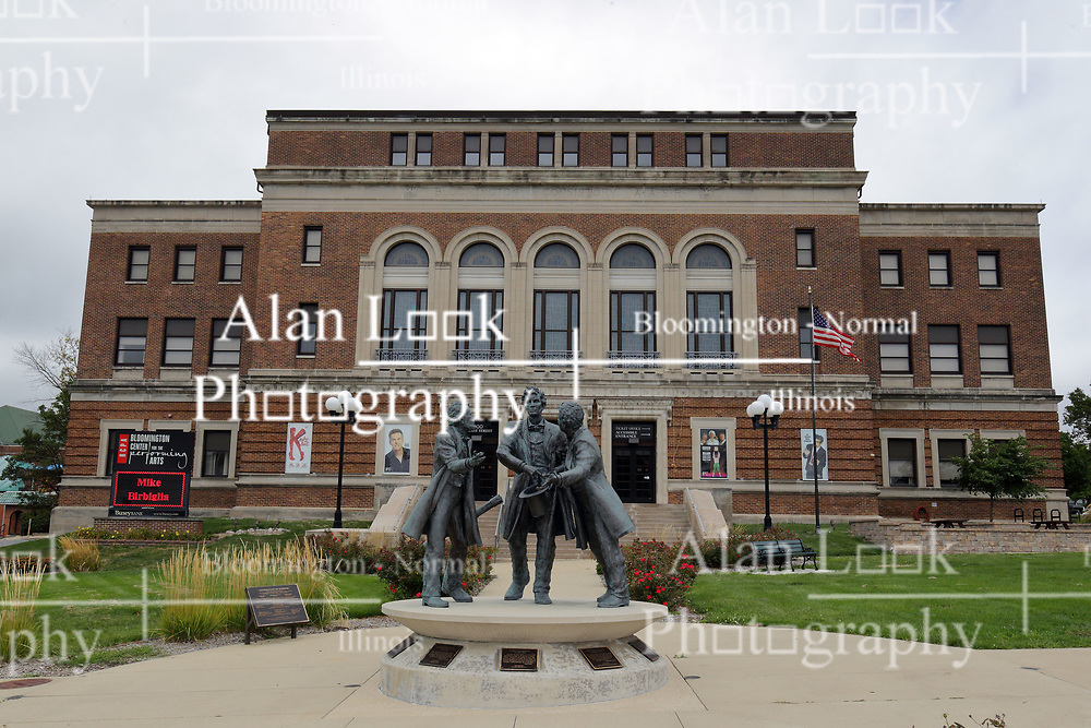 McLean County Illinois monuments and landmarks<br /> <br /> Abe Breaks up a Fight Statue in front of the McLean County Center for the Performing Arts in Bloomington Illinois poses Abe Lincoln breaking up a fight between 2 of his friends, David Davis and Jesse Fell.