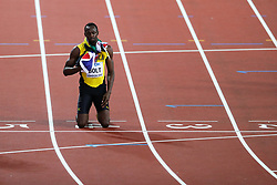 London, 2017 August 05. Usain Bolt bows out of competitive athletics, draped in the Jamaican and British flags at the IAAF World Championships London 2017. © Paul Davey.