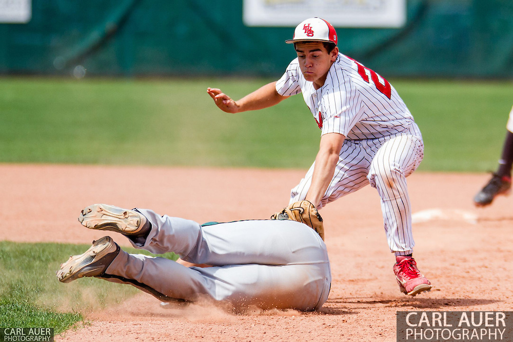 May 17th 2013: Holly Wildcats junior Jason Barth (21) tags out Fleming Wildcats senior Trevor Chintala (25) who fell down while trying to avoid being tagged out after being caught in a run down between 1st and 2nd during the CHSAA 1A Baseball final against the Holly Wildcats at All Star Park in Lakewood, Colorado