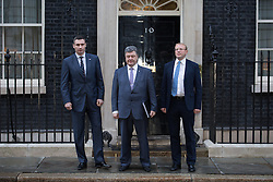 Ukrainian leaders meet with David Cameron. Leader of Ukrainian UDAR (Punch) political party Vitali Klitschko (L), Ukranian MPs Petro Poroshenko (C) and Andriy Shevchenko (R) pose for photographers outside 10 Downing Street before the meeting with Prime Minister David Cameron. 10 Downing Street, London, United Kingdom. Wednesday, 26th March 2014. Picture by Daniel Leal-Olivas / i-Images