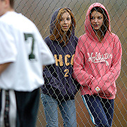 Marcellus, NY / 2004 - Elizabeth Peck, left, and Gina Christopher watch the boys run through pre-game exercises prior to a modified (7th-8th grade) soccer game between Marcellus and Bishop Ludden at the Marcellus athletic complex. Photo by Mike Roy