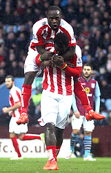 Stoke's Mame Biram Diouf and Victor Moses celebrate - Photo mandatory by-line: Robbie Stephenson/JMP - Mobile: 07966 386802 - 21/02/2015 - SPORT - Football - Birmingham - Villa Park - Aston Villa v Stoke City - Barclays Premier League
