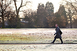 © Licensed to London News Pictures. 03/01/2017. London, UK. People walk in Hyde Park, London on a frosty morning as temperatures in the capital drop below zero celsius on Tuesday, 3 January 2017. Photo credit: Tolga Akmen/LNP