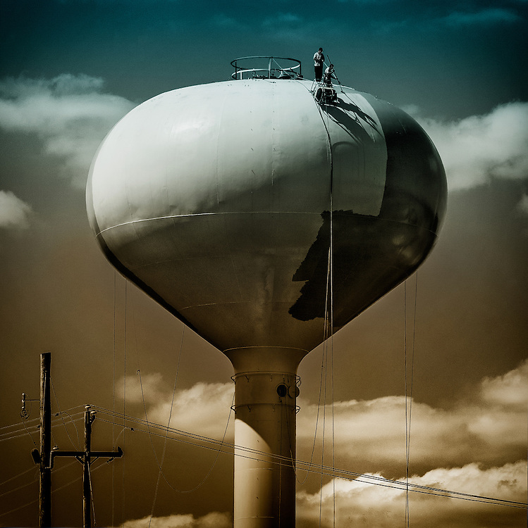 People working on a water tower in New Hope, Pennsylvania, Bucks County.