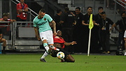 Inter Milan's Marcele Brazovic is tackled by Manchester United's Aaron Wan Bissaka during an International Champions Cup game won by Manchester United 1-0, Saturday, July 20, 2019, in Singapore. (Kim Teo/Image of Sport)