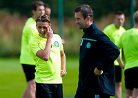 18/08/15<br /> CELTIC TRAINING<br /> LENNOXTOWN<br /> Celtic new boy Scott Allan (left) enjoys a chat with his manager Ronny Deila