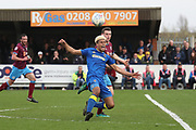 AFC Wimbledon striker Lyle Taylor (33) getting fouled outside of the box during the EFL Sky Bet League 1 match between AFC Wimbledon and Scunthorpe United at the Cherry Red Records Stadium, Kingston, England on 7 April 2018. Picture by Matthew Redman.