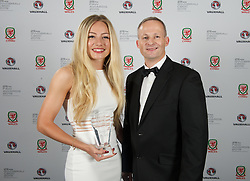 CARDIFF, WALES - Monday, October 5, 2015: Edwards Holiday's Stewart Isaac presents Wales' Charlie Estcourt with the Woman's Young Player of the Year Award  during the FAW Awards Dinner at Cardiff City Hall. (Pic by Ian Cook/Propaganda)