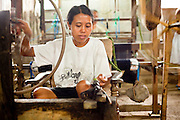Apr 23 - BALI, INDONESIA - A woman works in a weaving shop in central Bali.   Photo by Jack Kurtz/ZUMA Press