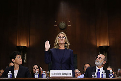September 27, 2018 - Washington, District of Columbia, U.S. - CHRISTINE BLASEY FORD (C) is sworn in before testifying the Senate Judiciary Committee with her attorneys DEBRA KATZ (L) and MICHAEL BROMWICH (R) in the Dirksen Senate Office Building on Capitol Hill. A professor at Palo Alto University and a research psychologist at the Stanford University School of Medicine, Ford has accused Supreme Court nominee Judge Kavanaugh of sexually assaulting her during a party in 1982 when they were high school students in suburban Maryland. In prepared remarks, Ford said, 'I don't have all the answers, and I don't remember as much as I would like to. But the details about that night that bring me here today are ones I will never forget. They have been seared into my memory and have haunted me episodically as an adult.'  (Credit Image: © Win McNamee/Pool via ZUMA Wire)
