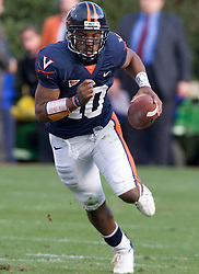 Virginia quarterback Jameel Sewell (10) scrambles up field.  The #8 ranked Virginia Tech Hokies defeated the #16 ranked Virginia Cavaliers 33-21 at Scott Stadium in Charlottesville, VA on November 24, 2007.